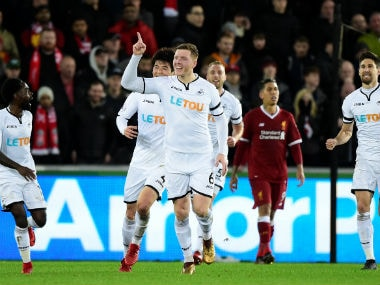 Swansea City's Alfie Mawson celebrates scoring their first goal. Reuters