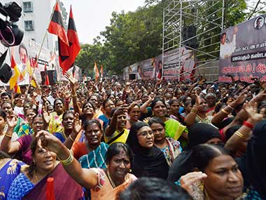 Protestors raise slogans during a demonstration to demand rollback of recent bus fare hike in Chennai on Saturday. PTI