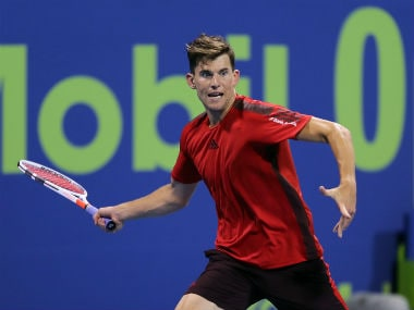 Austria's Dominic Thiem returns the ball to Slovenia's Aljaz Bedene. AFP