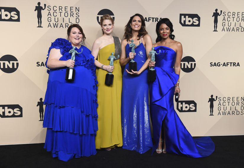 """Chrissy Metz, from left, Alexandra Breckenridge, Mandy Moore, and Susan Kelechi Watson pose in the press room with their awards for outstanding performance by an ensemble in a drama series for """"This Is Us"""" at the 24th annual Screen Actors Guild Awards at the Shrine Auditorium & Expo Hall on Sunday, Jan. 21, 2018, in Los Angeles. (Photo by Jordan Strauss/Invision/AP)"""