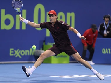 Tomas Berdych of the Czech Republic returns the ball to Jan-Lennard Struff of Germany during the first round of the ATP Qatar Open tennis competition in Doha. AFP