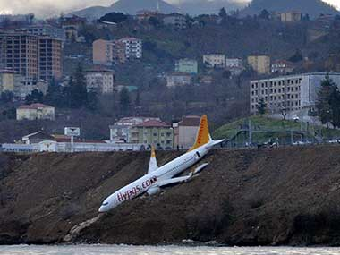 A Boeing 737-800 of Turkey's Pegasus Airlines after skidding off the runway downhill towards the sea at the airport in Trabzon, Turkey. AP