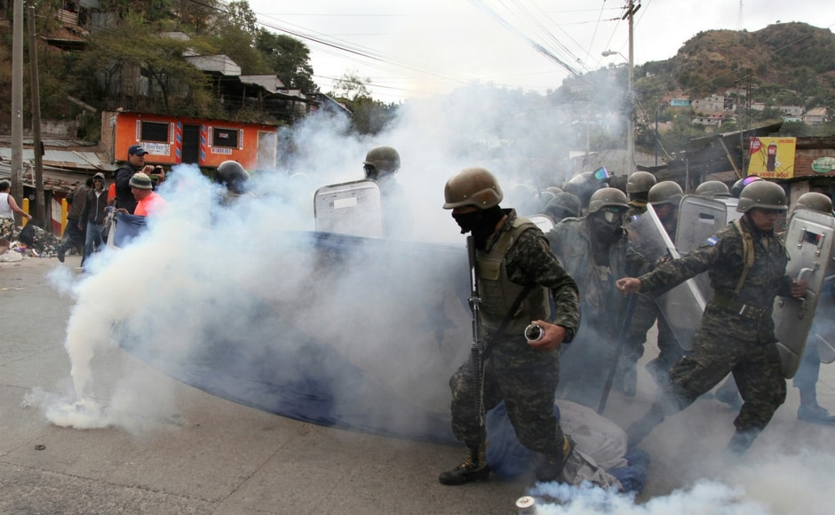 The government deployed police and soldiers to confront protesters. One demonstrator was shot dead dead on Saturday while seven others were detained. AP