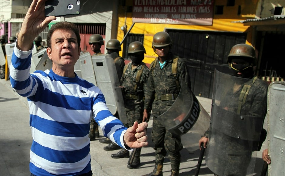 Opposition presidential candidate Salvador Nasralla made a livestream broadcast along with supporters during clashes with military police in the Policarpo Paz Garcia neighborhood of Tegucigalpa in Honduras on Saturday. AP
