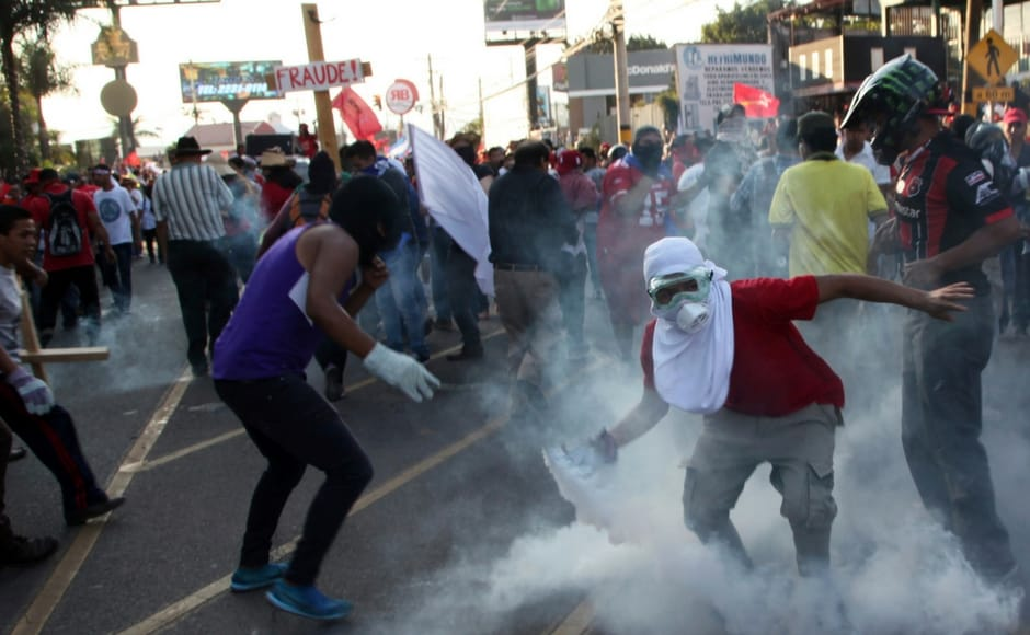 Protests turned violent with security forces firing tear gas and some marchers breaking windows and setting fires. AP