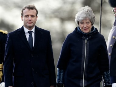 French President Emmanuel Macron and Britain's Prime Minister Theresa May walk back to the stand after inspecting the Guard of Honour ahead of the Anglo-French summit at the Royal Military College at Sandhurst, Camberley, England, Thursday, Jan. 18. AP
