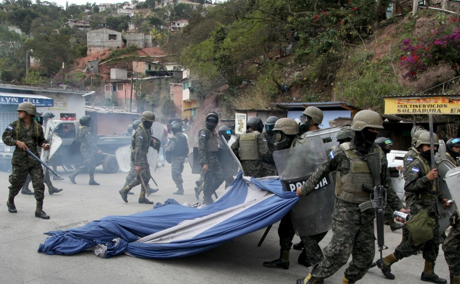 Activists blocked roads and clashed with police in Honduras as part of nationwide protests on Saturday against the contested re-election of President Juan Orlando Hernandez. AP