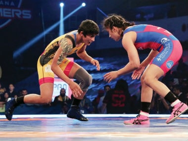 Vinesh Phogat and Ritu Phogat in action.