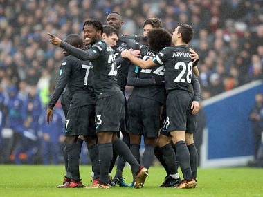 Chelsea's Eden Hazard celebrates with team members after scoring his side's first goal of the game against Brighton and Hove Albion. AP