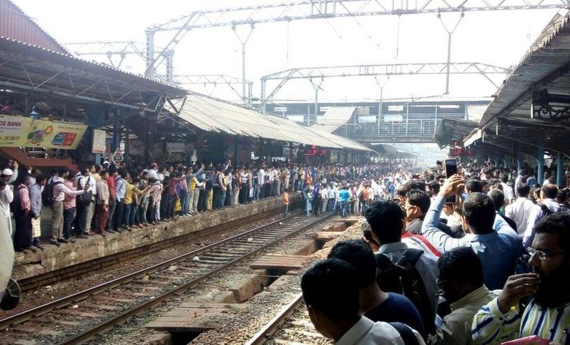 Protesters blocked railway track at the Ghatkopar station in Mumbai. Firstpost/ Jigar Mehta