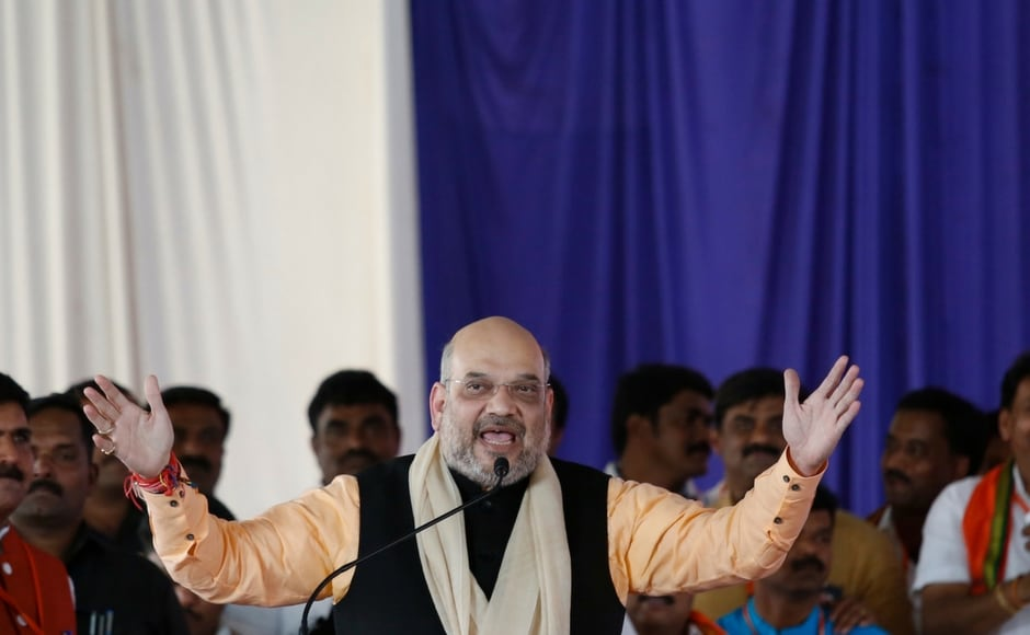 BJP chief Amit Shah, who is on a two-day visit to Karnataka where Assembly polls are due early in 2018, took potshots atthe Siddaramaiah government during a rally in at Holalkere inChitradurga on Wednesday. Image courtesy: 101Reporters/Nivedita Niranjankumar