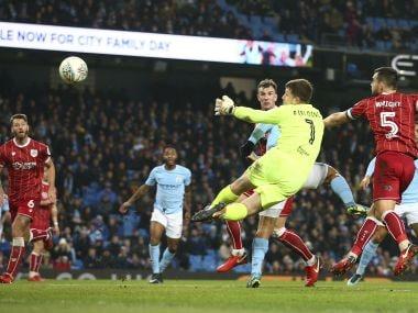 Bristol City's goalkeeper Frank Fielding watches as Sergio Aguero's header sails into the goal. AP