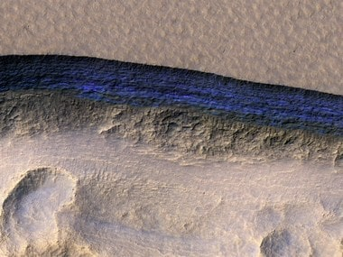 In this false color image captured by NASA's HiRISE camera, one of eight recently discovered stripes appears dark blue against the Martian terrain. NASA