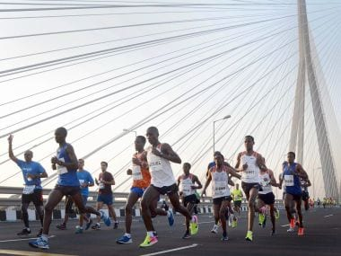 Mumbai Marathon runners at Bandra-Worli Sea Link on Sunday. PTI