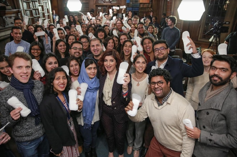 Malala is holding a sanitary pad and people are not having it