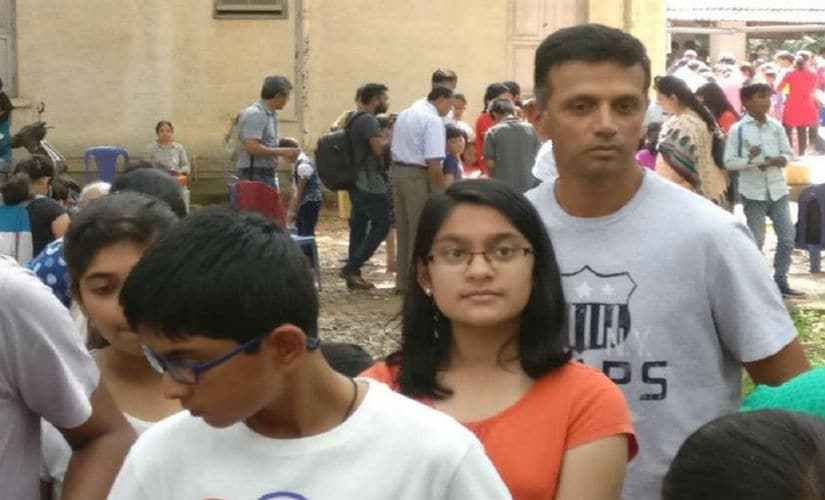 Rahul Dravid waits in queue with his kids at a science fair. Twitter