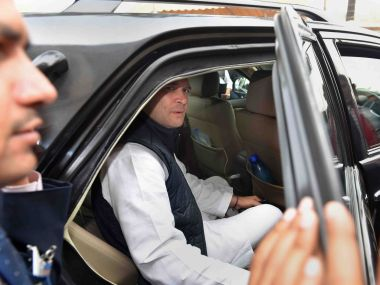 Congress chief Rahul Gandhi outside Parliament on Wednesday. PTI