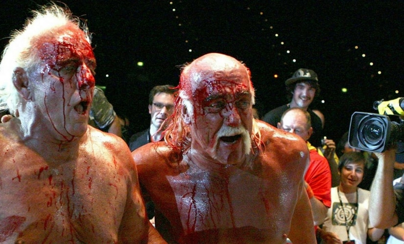 Ric Flair and Hulk Hogan after a bloody match/Image from YouTube.