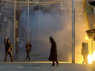 A teargas shell explodes near the protesters who were clashing with security forces following a protest against the alleged killing of two youth Army firing in Shopian district of South Kashmir. PTI