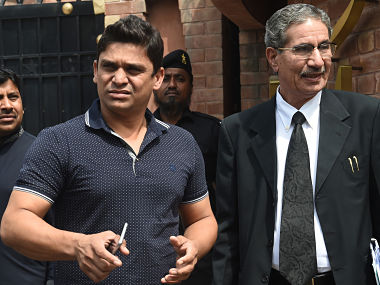 Suspended Pakistani cricketer Khalid Latif (L) leaves with his lawyer after appearing before a tribunal in Lahore on March 31, 2017. Pakistan batsman Khalid Latif will contest spot-fixing charges against him, his lawyer said March 31, in an ongoing scandal which has tainted Pakistani cricket and threatened years of work to clean up the country's image. The 31-year-old is one of five players under investigation in the case, which surfaced during the Pakistan Super League (PSL) held in February-March 2017. / AFP PHOTO / ARIF ALI