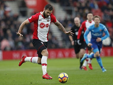 Southampton's English striker Charlie Austin controls the ball during the English Premier League football match between Southampton and Arsenal at St Mary's Stadium in Southampton, southern England on December 10, 2017. / AFP PHOTO / Adrian DENNIS / RESTRICTED TO EDITORIAL USE. No use with unauthorized audio, video, data, fixture lists, club/league logos or 'live' services. Online in-match use limited to 75 images, no video emulation. No use in betting, games or single club/league/player publications. /