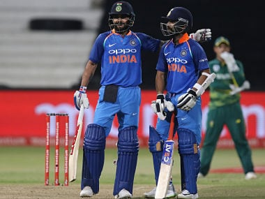 India's batsmen Virat Kohli (L) and Ajinkya Rahane celebrate the 100 partnership during the first One Day International (ODI) cricket match between South Africa and India at Kingsmead Cricket Ground on February 1, 2018 in Durban. / AFP PHOTO / ANESH DEBIKY