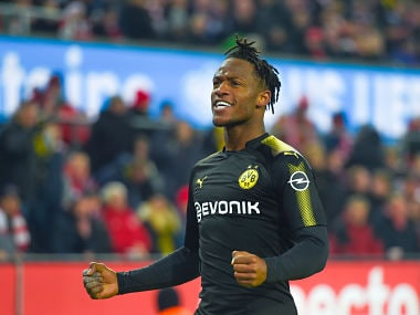 Dortmund's Michy Batshuayi celebrates after scoring a goal during the German first division Bundesliga football match FC Cologne vs Borussia Dortmund in Cologne, western Germany, on February 2, 2018. / AFP PHOTO / Patrik STOLLARZ / RESTRICTIONS: DURING MATCH TIME: DFL RULES TO LIMIT THE ONLINE USAGE TO 15 PICTURES PER MATCH AND FORBID IMAGE SEQUENCES TO SIMULATE VIDEO. == RESTRICTED TO EDITORIAL USE == FOR FURTHER QUERIES PLEASE CONTACT DFL DIRECTLY AT + 49 69 650050