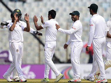 Bangladesh cricketers celebrates after the dismissal of the Sri Lanka cricket captain Dinesh Chandimal (R) during the fourth day of the first cricket Test between Bangladesh and Sri Lanka at Zahur Ahmed Chowdhury Stadium in Chittagong on February 3, 2018. / AFP PHOTO / MUNIR UZ ZAMAN