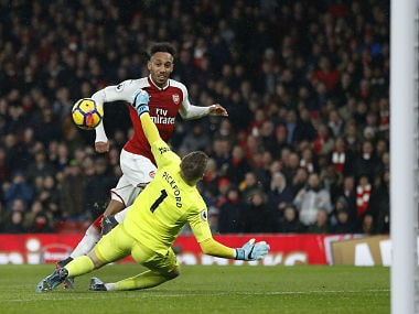 Arsenal's Gabonese striker Pierre-Emerick Aubameyang scores the team's fourth goal during the English Premier League football match between Arsenal and Everton at the Emirates Stadium in London on February 3, 2018. / AFP PHOTO / IKIMAGES / Ian KINGTON / RESTRICTED TO EDITORIAL USE. No use with unauthorized audio, video, data, fixture lists, club/league logos or 'live' services. Online in-match use limited to 45 images, no video emulation. No use in betting, games or single club/league/player publications. /