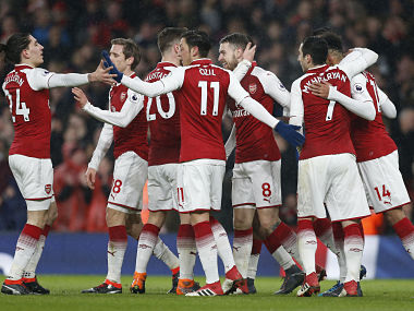 Arsenal's Welsh midfielder Aaron Ramsey (C) celebrates with teammates scoring the team's third goal during the English Premier League football match between Arsenal and Everton at the Emirates Stadium in London on February 3, 2018. / AFP PHOTO / IKIMAGES / Ian KINGTON / RESTRICTED TO EDITORIAL USE. No use with unauthorized audio, video, data, fixture lists, club/league logos or 'live' services. Online in-match use limited to 45 images, no video emulation. No use in betting, games or single club/league/player publications. /