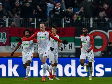 Augsburg's Austrian forward Michael Gregoritsch (C) celebrates his goal during the German first division Bundesliga football match 1 FC Augsburg vs Eintracht Frankfurt in Augsburg, southern Germany, on February 4, 2018. / AFP PHOTO / Guenter SCHIFFMANN / RESTRICTIONS: DURING MATCH TIME: DFL RULES TO LIMIT THE ONLINE USAGE TO 15 PICTURES PER MATCH AND FORBID IMAGE SEQUENCES TO SIMULATE VIDEO. == RESTRICTED TO EDITORIAL USE == FOR FURTHER QUERIES PLEASE CONTACT DFL DIRECTLY AT + 49 69 650050
