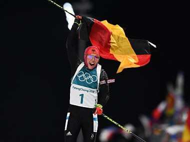 Germany's Laura Dahlmeier crosses the finish line to win gold in the women's 10km pursuit biathlon event during the Pyeongchang 2018 Winter Olympic Games on February 12, 2018, in Pyeongchang. / AFP PHOTO / FRANCK FIFE