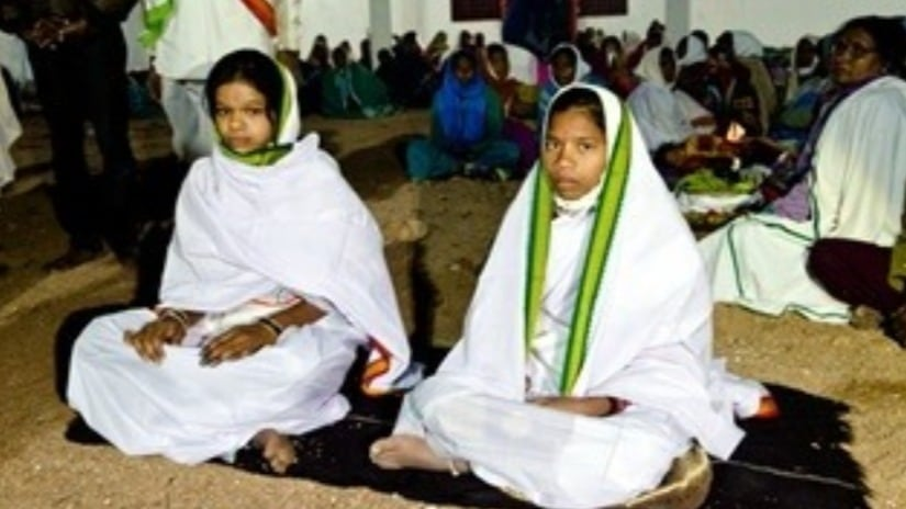 The two young brides who will lead the Bheti-Koriad to the Nagoba temple, accompanied with traditional music and fanfare, for a formal introduction to their clan God