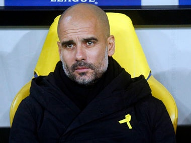 FILE - In this Wednesday, Dec. 6, 2017 file photo, Manchester City coach Josep Guardiola looks on during their Champions League group F soccer match against Shakhtar Donetsk at the Metalist Stadium in Kharkiv, Ukraine. The English Football Association on Friday, Feb. 23, 2018 has charged Manchester City manager Pep Guardiola for promoting a political message by wearing a ribbon to support of imprisoned and ousted pro-independence Catalan politicians. Guardiola was born in Catalonia and is revered in the region because of his links with Barcelona's soccer team, as both a player and coach.(AP Photo/Efrem Lukatsky, file)
