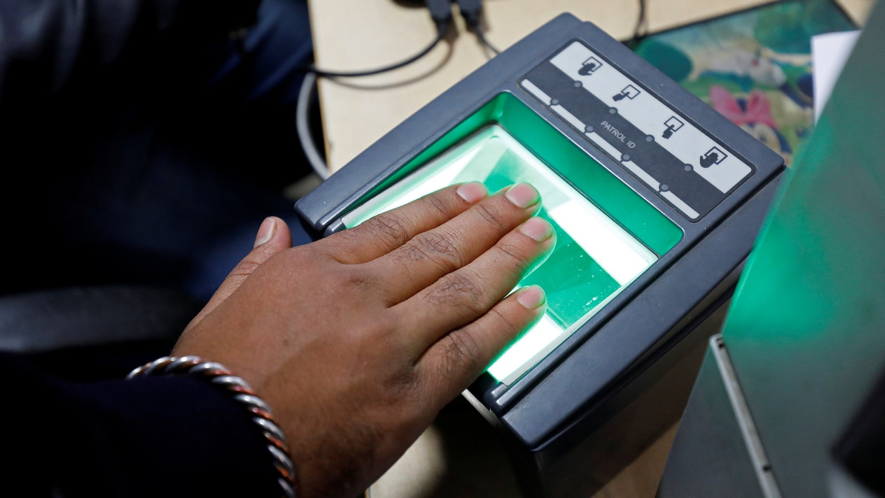 A woman goes through the process of finger scanning for the Unique Identification (UID) database system, Aadhaar, at a registration centre in New Delhi, India. Image: Reuters