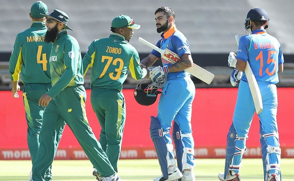 Virat Kohli is congratulated by South African players after the batsman remained unbeaten at 160 propelling India to 303/6 in their 50 overs. Image courtesy: Twitter @BCCI