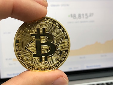 Bitcoin falls more than 15 percent to a three-month low of $6,853.53 on 5 February