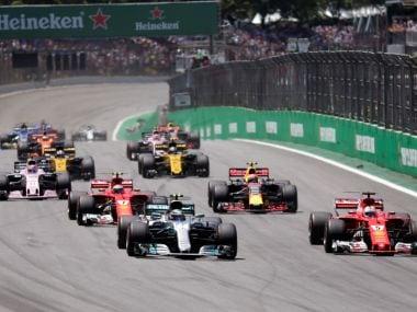 File photo of Ferrari's Sebastian Vettel and Mercedes' Valtteri Bottas at the start of Brazilian Grand Prix 2017. Reuters