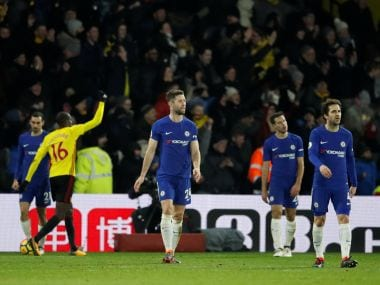 Chelsea players look dejected after conceding a goal. REUTERS