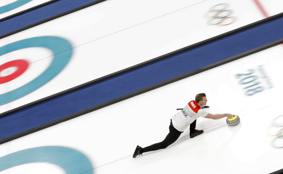 Magnus Nedregotten of Norway delivers a stone during the curling mixed doubles semi-final. Reuters