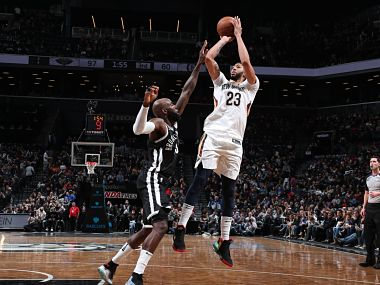 Anthony Davis scores past a Brooklyn Nets' player. Image courtesy: Twitter @NBA