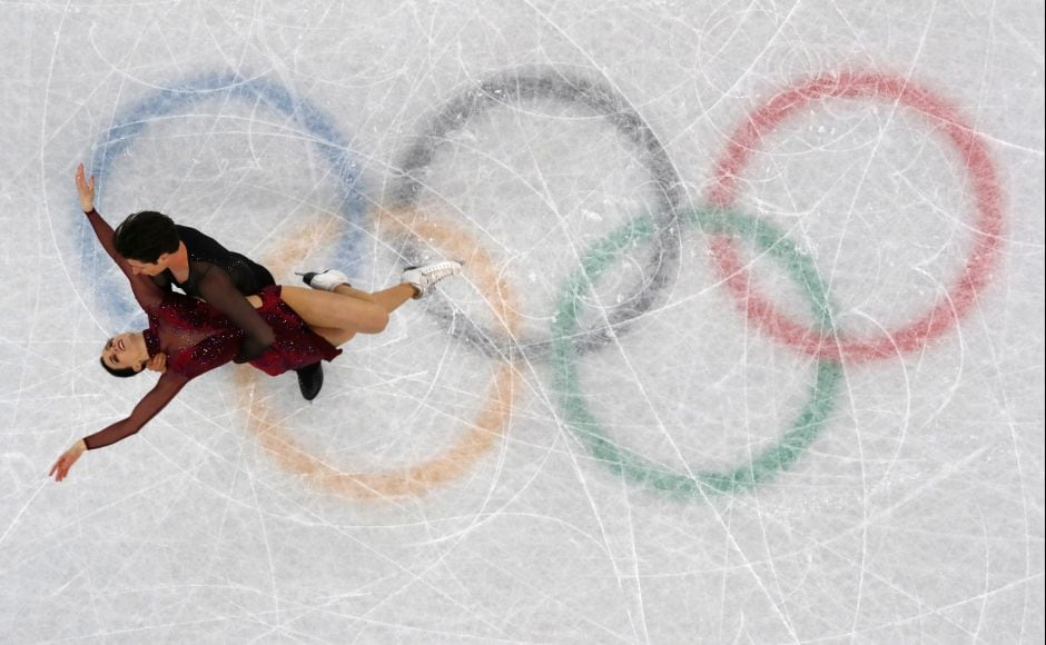Tessa Virtue and Scott Moir of Canada compete in the Team Event Ice Dance Free Dance competition final. Reuters