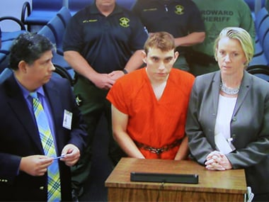 Accused Nikolas Cruz confesses to Florida school shooting, says he discarded rifle to blend in with crowd fleeing campus