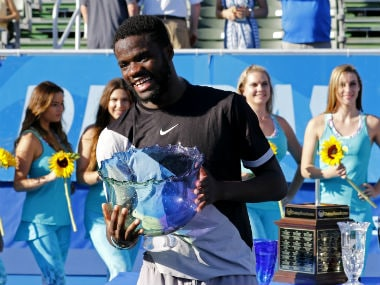 Frances Tiafoe of the US holds the trophy after he defeated Peter Gojowczyk of Germany 6-1, 6-4 in his first ATP World Tour win. AP