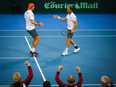 Tim Puetz (R) and teammate Jan-Lennard Struff (L) of Germany celebrate their victory in the doubles. AFP