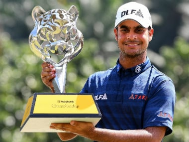 Indian golfer Shubhankar Sharma poses with the trophy. AFP