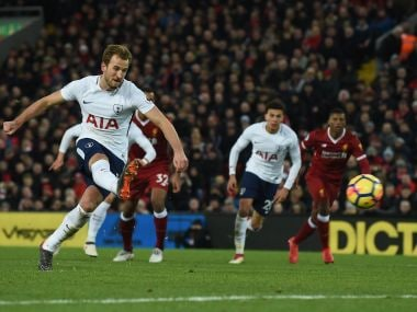 Tottenham Hotspur's Harry Kane takes a penalty against Liverpool at Anfield. AFP