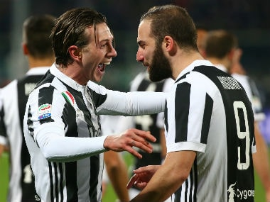 Juventus' Federico Bernardeschi celebrates with Gonzalo Higuain after scoring their first goal. Reuters