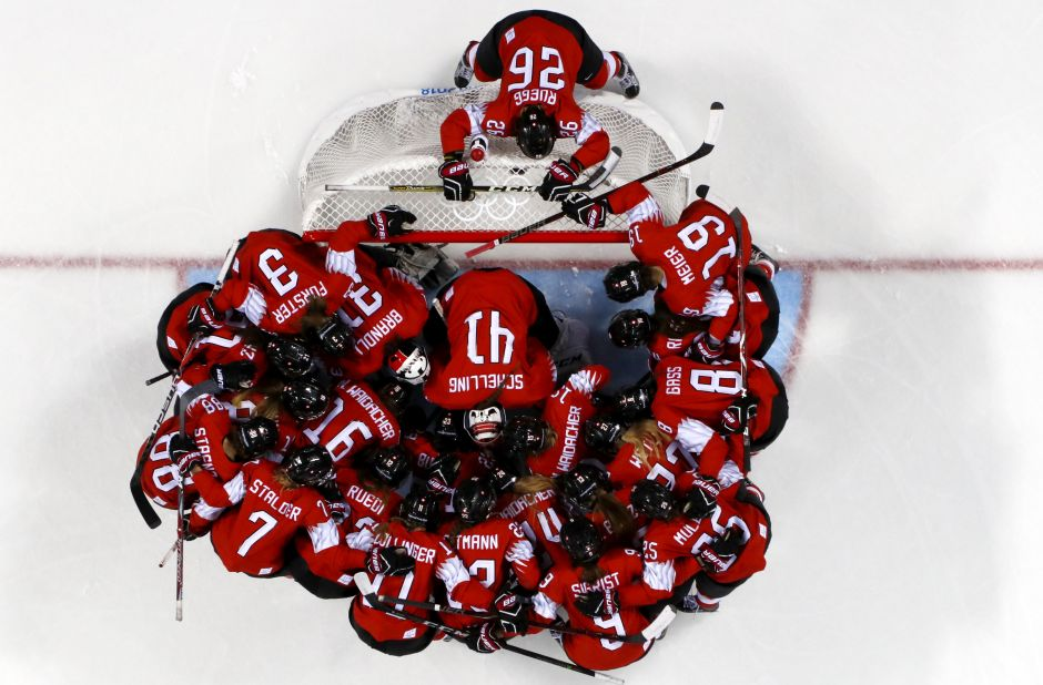 Players of Team Switzerland huddle before the start of their preliminary round against Japan. Reuters