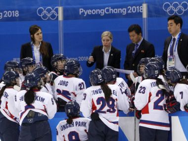 Korea head coach Sarah Murray talks to the joint Korean ice hockey team during their match against Switzerland on 10 February. Reuters